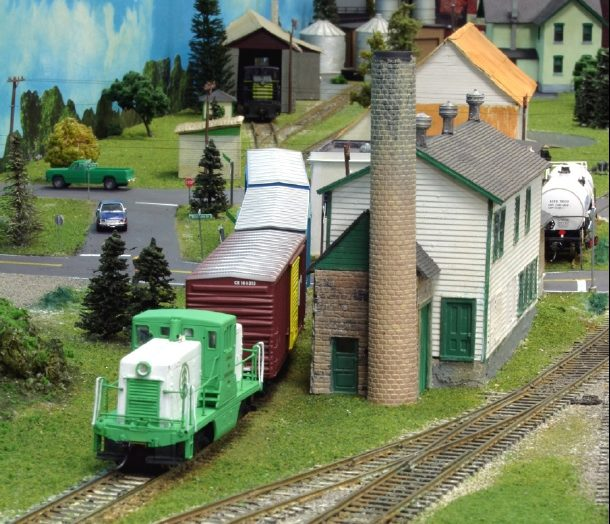 Freight leaving Lowville passing former creamery