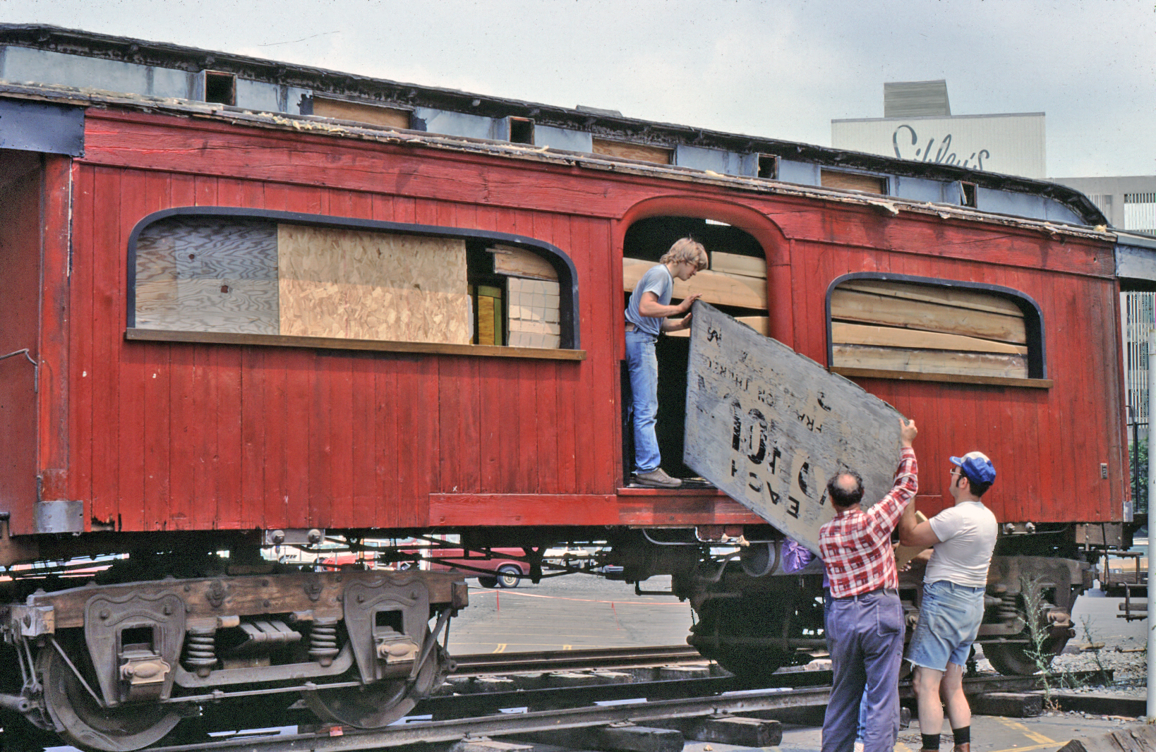 CNY NRHS members prepare baggage car for moving in July, 1984